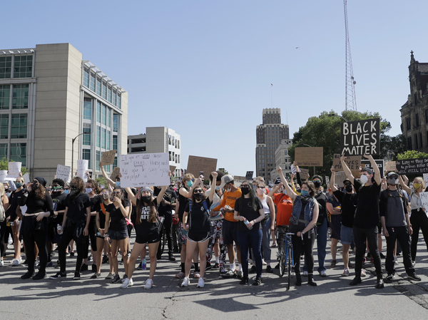 Protesters prepare to march in the streets on Monday in St. Louis.