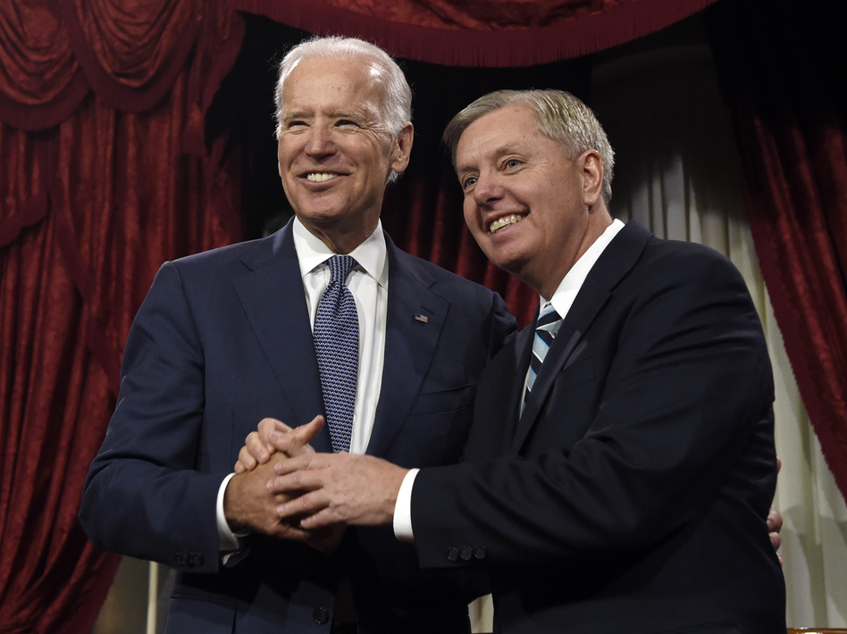 Vice President Joe Biden shares a laugh with Sen. Lindsey Graham, R-S.C., back in 2015. Graham's Judiciary Committee is beginning an investigation with links to Biden and his family. (Susan Walsh/AP)