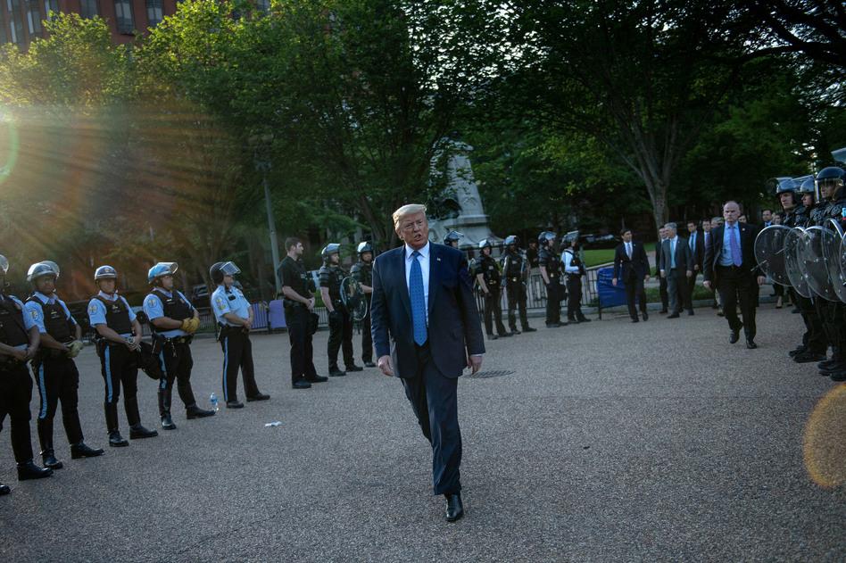 US President Trump leaves the White House on foot to go to St John's Episcopal church across Lafayette Park in Washington, D.C. Monday. (Brendan Smialowski / AFP via Getty Images)