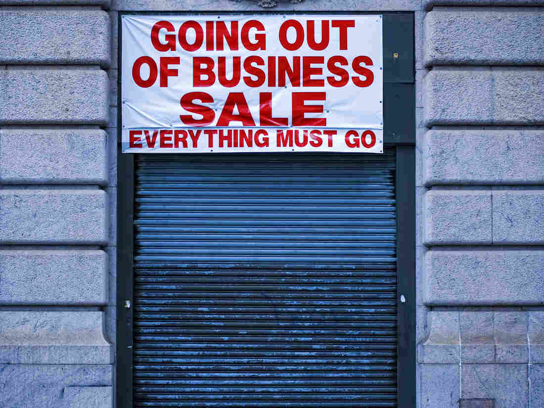 """Shuttered store with """"Going out of Business"""" sign"""