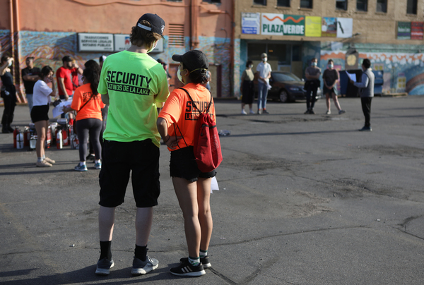 Security Latinos De La Lake volunteers wear bright T-shirts prominently displaying the group's name, in part, to let law enforcement know who they are.