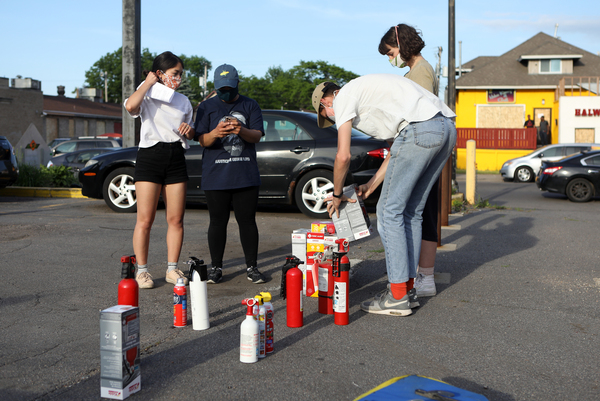 Residents are given fire extinguishers in case protesters set businesses ablaze as they have in Minneapolis and across the nation.