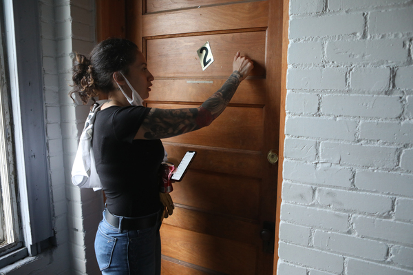 Volunteer Cesia Baires checks on neighbors to make they are safe as sometimes-violent and destructive protests continue.