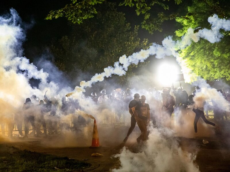 Tear gas rises as protesters face off with police during a demonstration on May 31 outside the White House over the death of George Floyd at the hands of Minneapolis Police. Samuel Corum/AFP via Getty Images