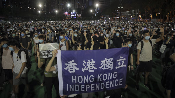 """People attending a vigil for the victims of the 1989 Tiananmen Square massacre hold a banner reading """"Hong Kong independence"""" at Victoria Park in Causeway Bay, Hong Kong, on Thursday. Official applications for the rally were denied."""