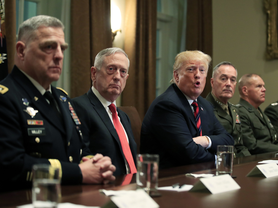 President Donald Trump in October 2018 with, from left, Army Chief of Staff Gen. Mark Milley, Defense Secretary Jim Mattis, Chairman of the Joint Chiefs of Staff Gen. Joseph Dunford and Marine Corps Commandant Gen. Robert Neller. (Manuel Balce Ceneta/AP)