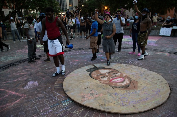 Taylor's name has become the foremost emblem of the protests against police violence in Louisville. Her face is painted and chalked throughout the city, including here at Jefferson Square Park in downtown Louisville.