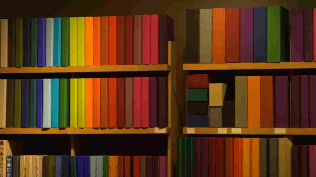 Image of a bookshelf with multi-colored books.
