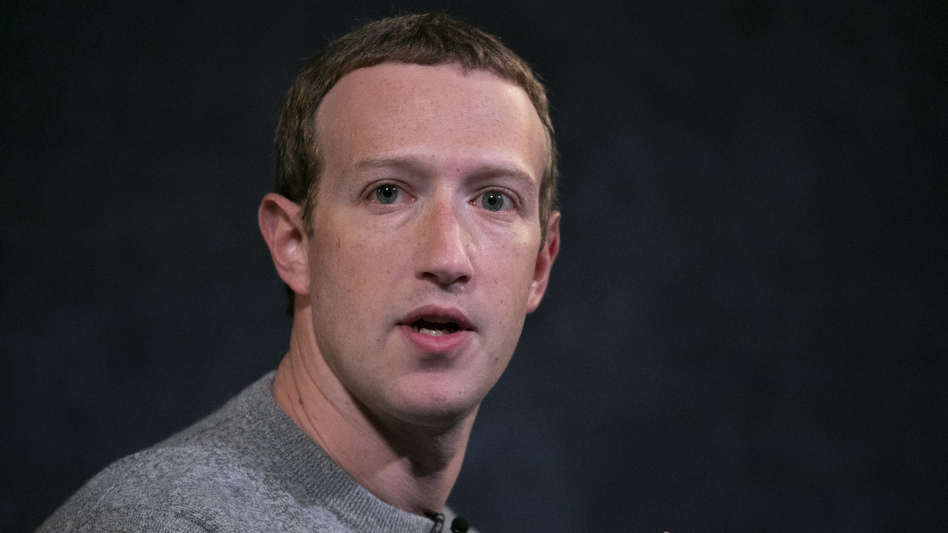 Mark Zuckerberg says Facebook will consider labeling some posts that break its rules, rather than simply taking them down or leaving them up. (Mark Lennihan/AP)