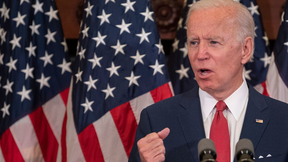 Democratic presidential candidate Joe Biden speaks in Philadelphia on Tuesday about the unrest over racism and police brutality. On Monday, his campaign put out a statement opposing efforts to defund police. (Jim Watson /AFP via Getty Images)