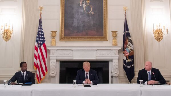 President Trump, center, hosts a roundtable discussion with law enforcement officials on police and community relations in the State Dining Room at the White House Monday.