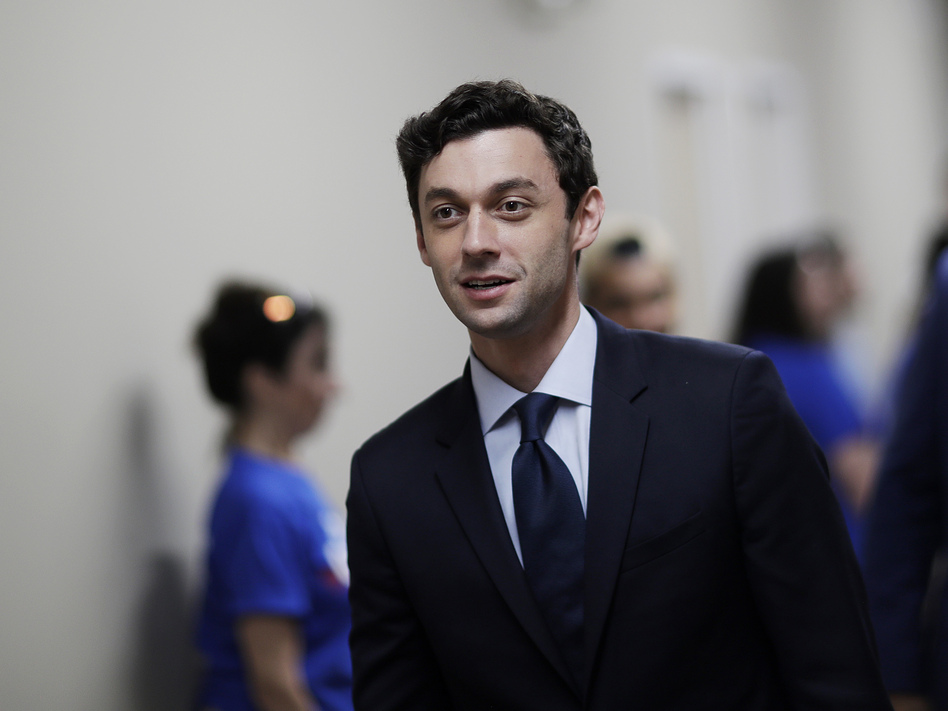 Jon Ossoff leaves a campaign office during a 2017 race after meeting with supporters in Marietta, Ga. Ossoff will face Republican Sen. David Perdue in November. (David Goldman/AP)