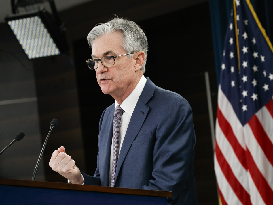 Federal Reserve Chair Jerome Powell speaks during a news conference in Washington on March 3. Companies can borrow money from the Fed under its new lending programs, but the central bank's effort to help the economy has had lopsided results. (Jacquelyn Martin/AP)