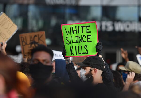 White Fragility author Robin DiAngelo says the question white people should be asking themselves is not have I been shaped by race, but how have I been shaped by race? Above, protesters demonstrate in New York on June 1.