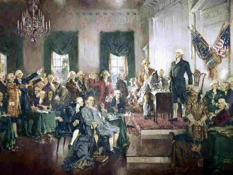 The signing of the Constitution of the United States, with George Washington, Benjamin Franklin, Thomas Jefferson, and others at the Constitutional Convention of 1787. Artwork by Howard Chandler Christy.