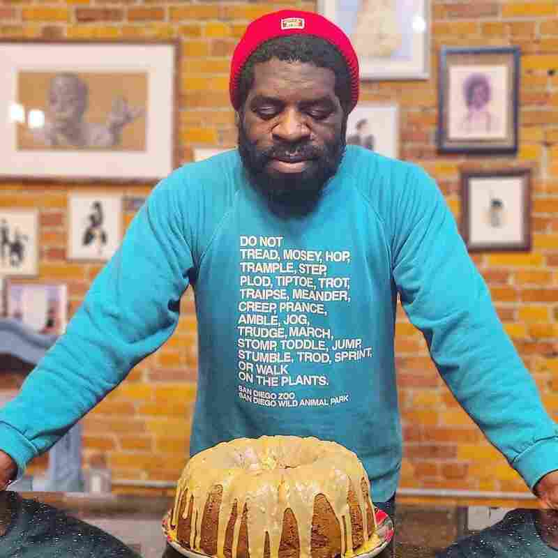 Hanif Abdurraqib and a Bundt cake he made.