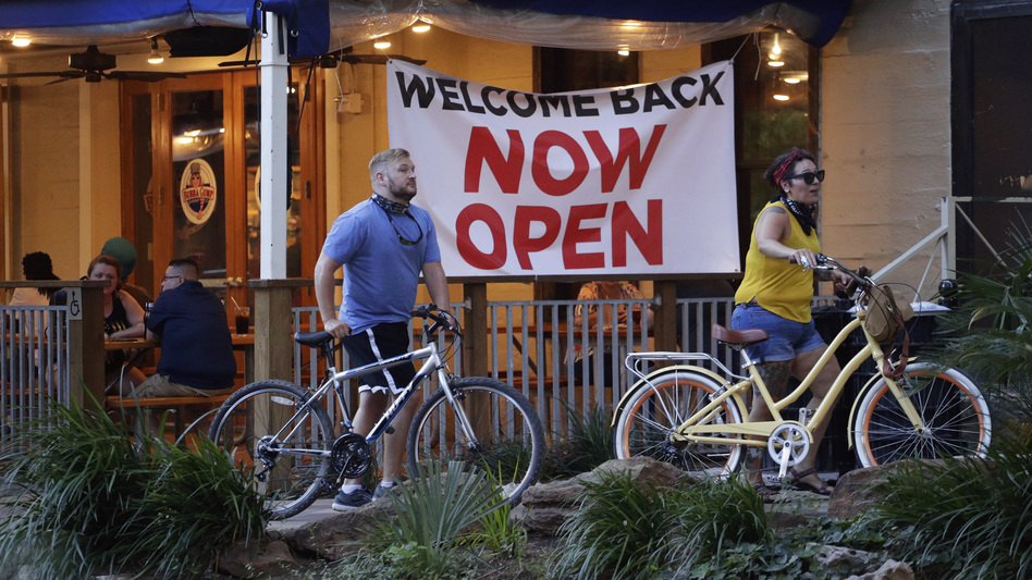 Visitors to the River Walk pass a restaurant that reopened in San Antonio last last month. Like other states, Texas continues to reopen despite the persistence of the COVID-19 pandemic. (Eric Gay/AP)