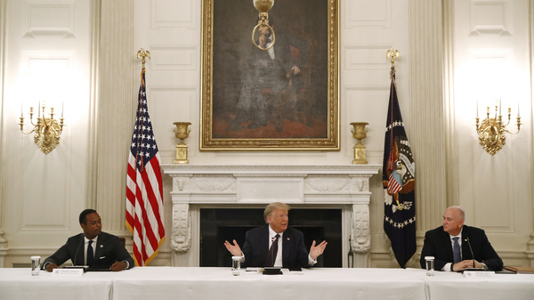 President Trump speaks during a roundtable discussion with law enforcement officials on Monday, at the White House. Seated with Trump are Kentucky Attorney General Daniel Cameron (left) and Patrick Yoes, national president of the Fraternal Order of Police.