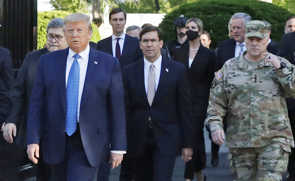 """Gen. Mark Milley (right) appears with President Trump as he departs the White House en route to St. John's Church on June 1. Milley now says his presence """"created a perception of the military involved in domestic politics."""" (Patrick Semansky/AP)"""