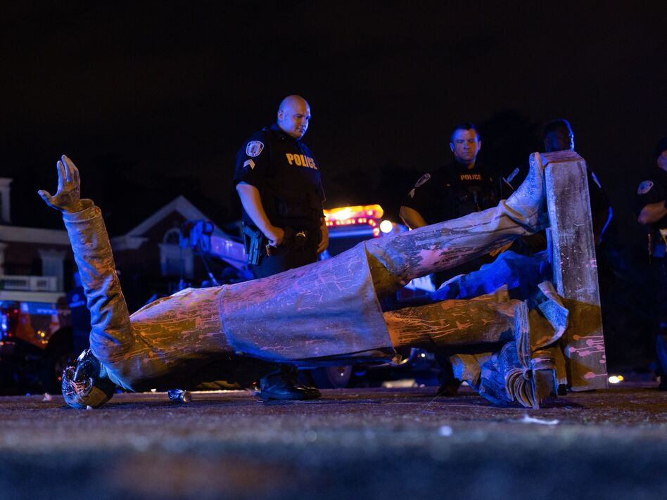 A statue of Confederate States President Jefferson Davis lies on the street after protesters pulled it down in Richmond, Va., on Wednesday. (Parker Michels-Boyce/AFP via Getty Images)