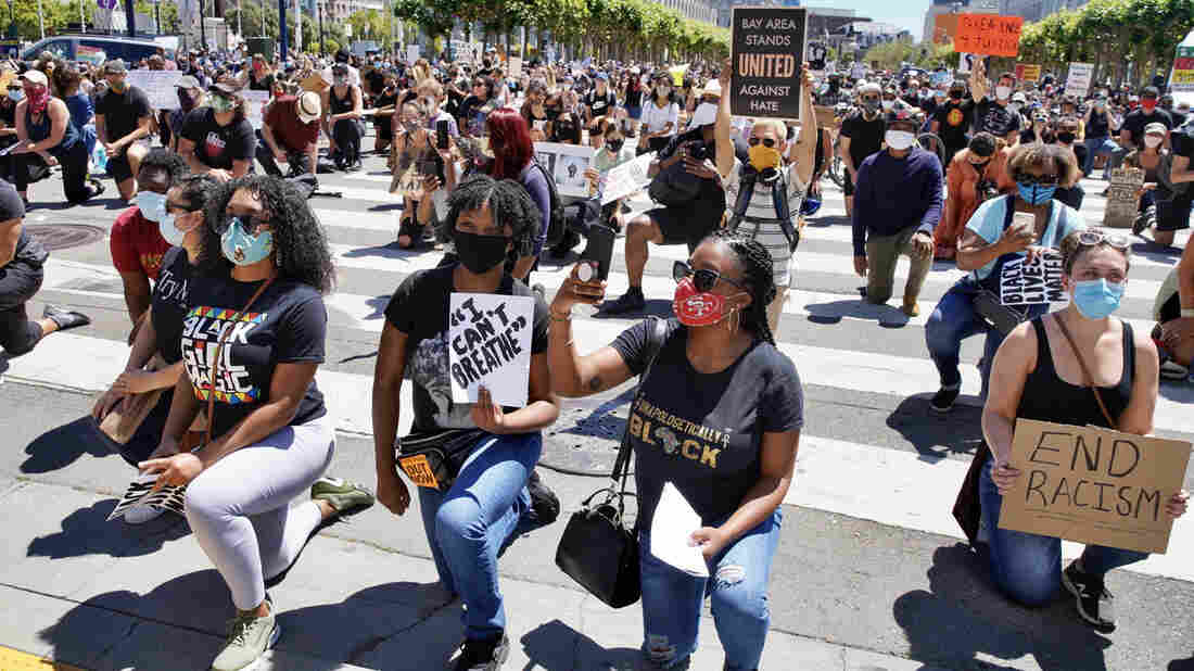 Hundreds of protesters rally outside City Hall on Tuesday, June 9, 2020, in San Francisco, California. Protestors are seen holding signs and kneeling. (Santiago Mejia/The San Francisco Chronicle via Getty Images)