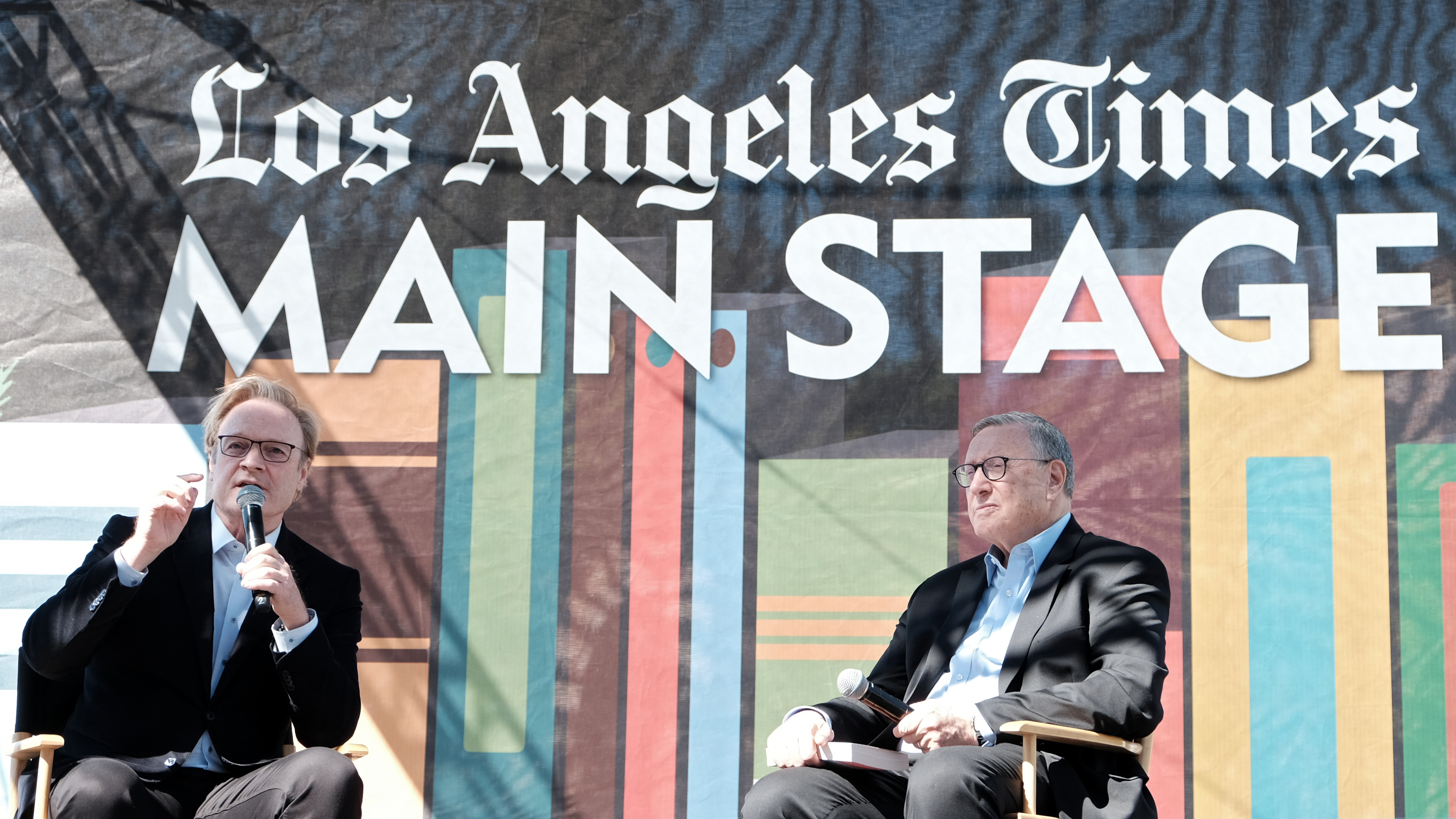 LA Times Executive Editor Norman Pearlstine (right) listens to Lawrence O'Donnell at the 2019 Los Angeles Times Festival of Books in April 2019.