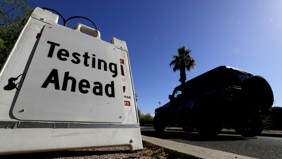 A vehicle arrives at a testing site for the coronavirus last month at Steele Indian School Park in Phoenix. Arizona has seen a surge of new coronavirus cases recently. (Matt York/AP)