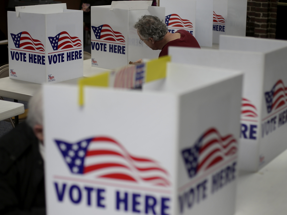 Voter registration efforts have been disrupted by the pandemic and engagement by black and Latino voters has come into focus amid the national discussion about race and law enforcement. Charlie Riedel/AP