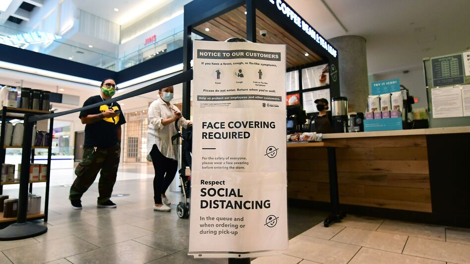Social distancing instructions are posted at California's Westfield Santa Anita shopping mall on June 12, as local businesses enter Phase 3 reopening. (Frederic J. Brown/AFP/Getty Images)