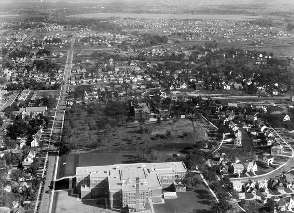 A photograph, taken circa 1928, shows southwest Minneapolis. At the time, according to Kirsten Delegard, this part of Minneapolis was being rapidly developed by investors, who blanketed new neighborhoods with racial covenants that reserved them for the exclusive use of white people.