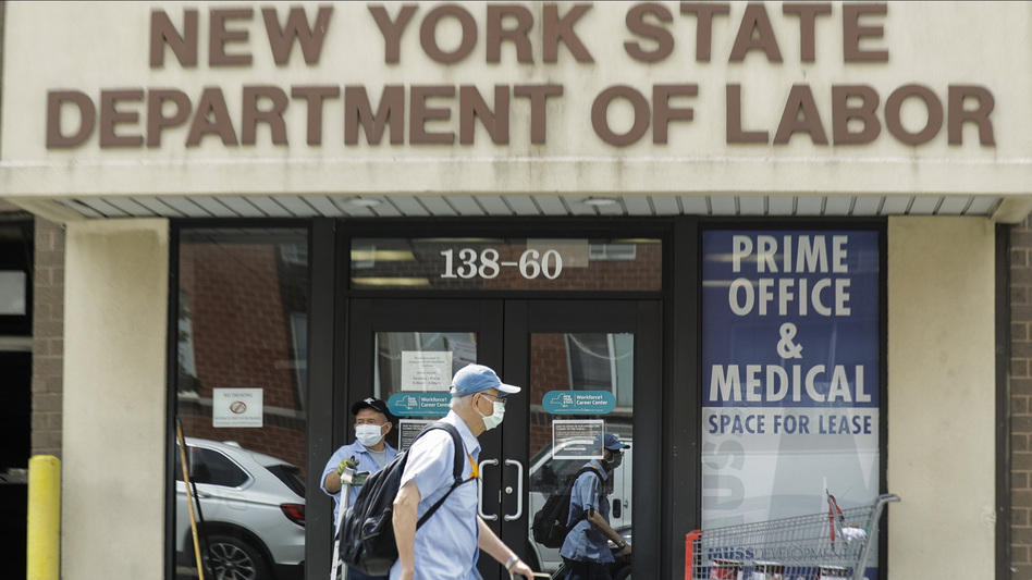 Pedestrians pass a New York State Department of Labor office June 11 in Queens. The Federal Reserve expects the U.S. unemployment rate to still be more than 9% by the end of 2020. (Frank Franklin II/AP)