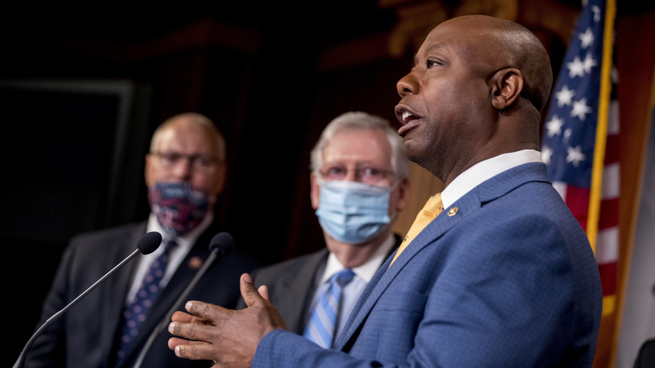 Sen. Tim Scott, R-S.C.,  right, addresses a news conference Wednesday to announce a Republican police reform bill on Capitol Hill. (Andrew Harnik/AP)