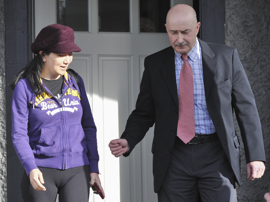 Huawei Chief Financial Officer Meng Wanzhou leaves her Vancouver home with a security detail to appear in British Columbia Supreme Court in Vancouver in March. (Don Mackinnon/AFP/Getty Images)