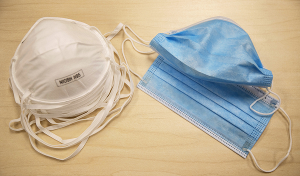N95 particulate respirator masks (left) block at least 95% of small airborne particulates in the air. However, they are still in short supply and should be reserved for medical workers. Surgical face masks (right) are most effective at protecting others from the wearer's droplets.