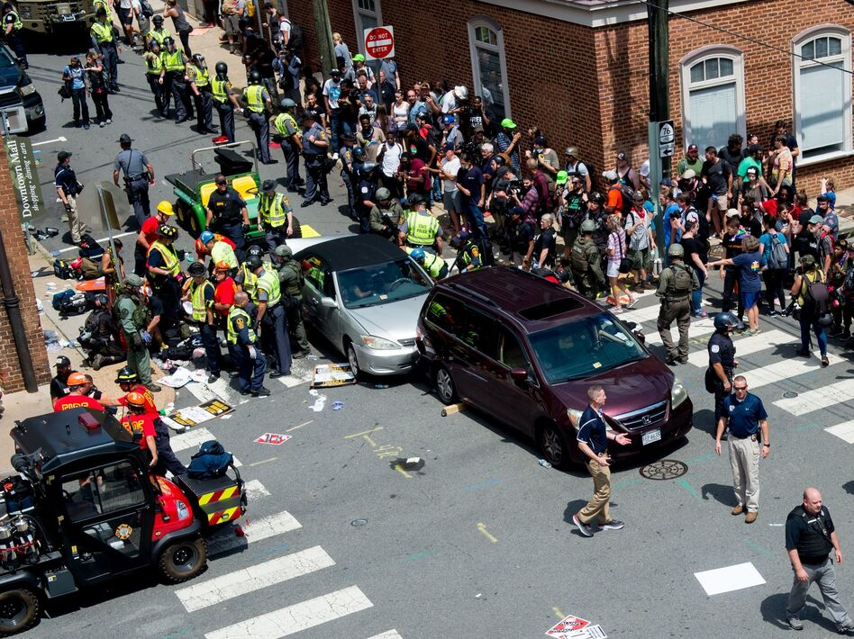 People receive first-aid after a car ran into a crowd of protesters in Charlottesville, Va., on Aug. 12, 2017. Terrorism researchers say right-wing extremists are turning cars into weapons in response to the ongoing protests against police misconduct. (Paul J. Richards/AFP via Getty Images)
