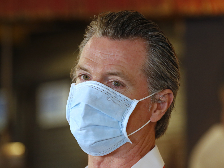 California Gov. Gavin Newsom, here in Sacramento on Friday, has ordered face coverings be required in public spaces statewide. (Rich Pedroncelli/AP)
