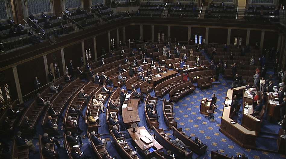Lawmakers are directed to practice social distancing for debates and votes on the floor of the House of Representatives. (House Television via AP)