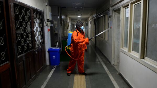 A health worker sprays disinfectant inside government offices as a preventive measure against the COVID-19 coronavirus.