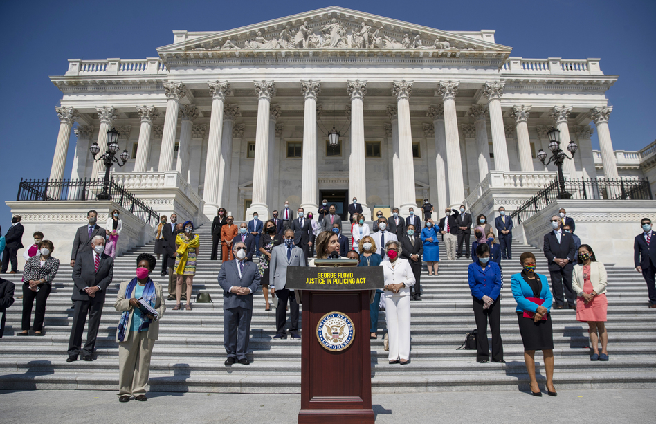 House Speaker Nancy Pelosi of California, joined by House Democrats spaced for social distancing, spoke at a press conference on the House East Front Steps of the Capitol ahead of the House vote on the George Floyd Justice in Policing Act of 2020. (Carolyn Kaster/AP)