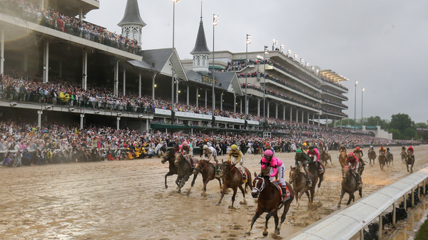 Riders cross the finish line at the 145th running of the Kentucky Derby at Churchill Downs last year.