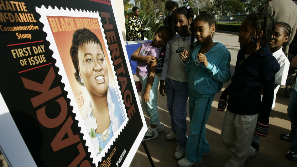 Los Angeles school children attend a ceremony unveiling a commemorative U.S. Postal Service stamp for actor Hattie McDaniel in 2006, in Beverly Hills, Calif. McDaniel, also a singer, radio and television personality, was the first African American to win an Oscar, for her portrayal of Mammy in <em>Gone With the Wind.</em>