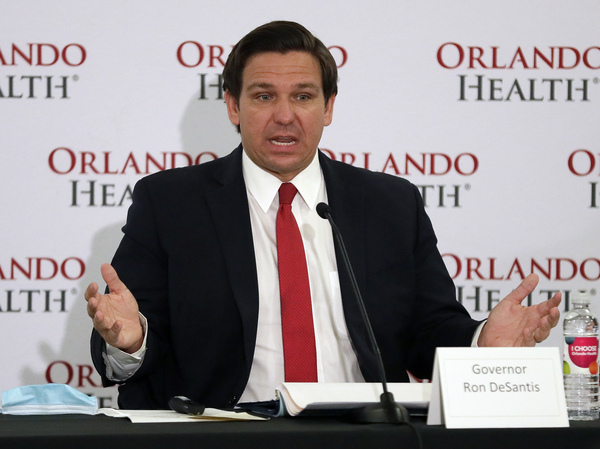 Florida Gov. Ron DeSantis speaks at a news conference at Orlando Regional Medical Center on Tuesday about Florida's coronavirus caseload topping 100,000.