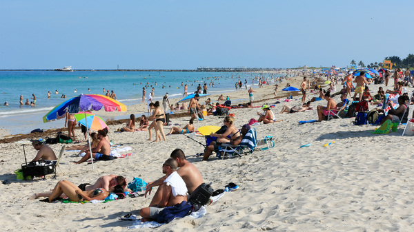 Beachgoers take advantage of the opening of South Beach on June 10, 2020 in Miami Beach, Florida after officials eased restrictions put in place to contain COVID-19.
