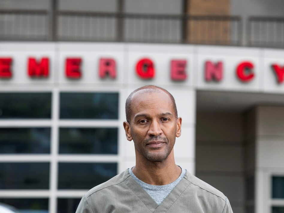 Dr. William Strudwick stands outside Howard University Hospital, where he works as an attending physician in the emergency department. (Tyrone Turner/WAMU)