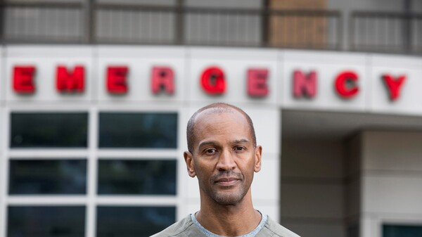 Dr. William Strudwick stands outside Howard University Hospital, where he works as an attending physician in the emergency department.