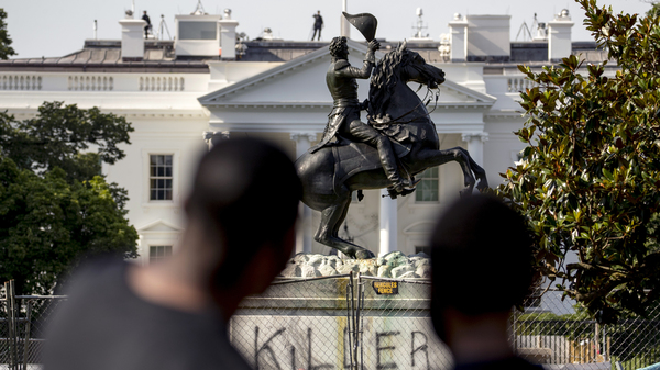 The Justice Department has charged four men in connection with the June 22 attempt to take down the statue of Andrew Jackson in Lafayette Park in Washington, D.C.