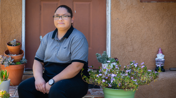 Carmen Quintero works as a supervisor at a distribution center for N95 masks. She owes $1,840 for other care she received when she tried to get a coronavirus test.