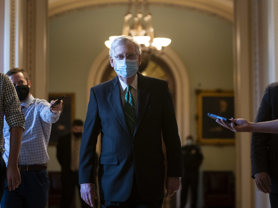 Senate Majority Leader Mitch McConnell walks back to his office after delivering opening remarks at the U.S Capitol on Wednesday. (Al Drago/Bloomberg via Getty Images)
