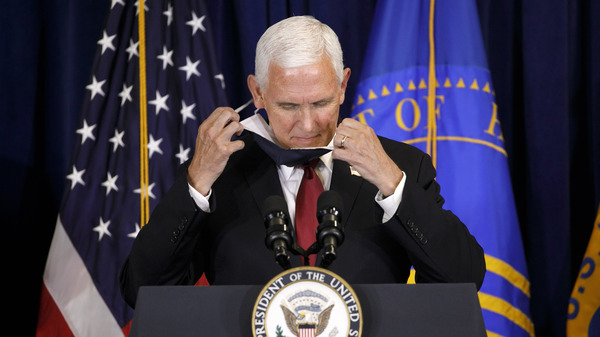 Vice President Pence removes his mask as he arrives at the lectern to speak to the U.S. Public Health Service at its headquarters in Rockville, Md., on Tuesday.