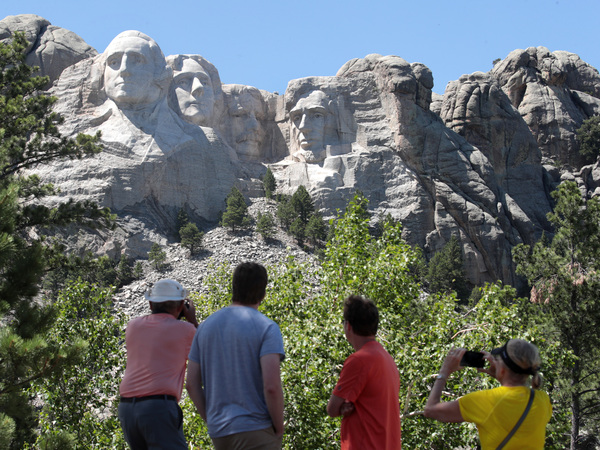 Tourists visit Mount Rushmore National Monument on Wednesday. President Trump is expected to visit the federal monument in South Dakota and give a speech before a fireworks display on Friday.